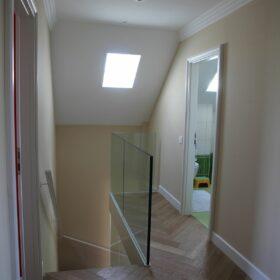 corridor - new glass railing